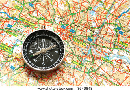 stock-photo-compass-over-the-map-of-uk-london-suburbs-3649848